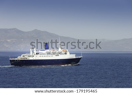 cruise ship arriving in port of Athens with tourists aboard, Greece - stock photo