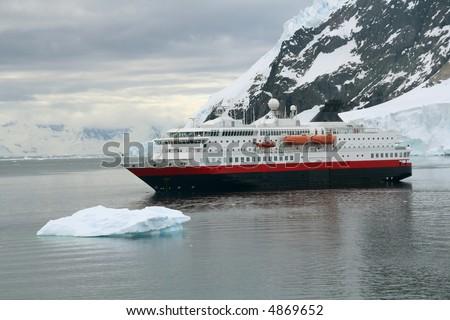 Cruise ship at anchor with glaciers and icebergs,Neko Harbor, Andvord Bay,Antarctica - stock photo