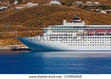 Cruise ship at Mykonos Port cyclades Greece - stock photo
