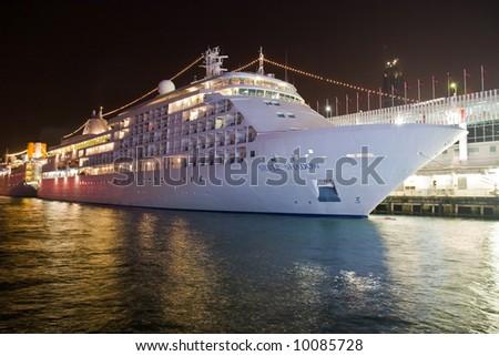 Cruise ship at night docked. - stock photo