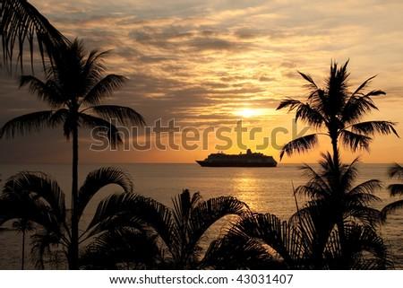 Cruise Ship at sunset in Hawaii - stock photo