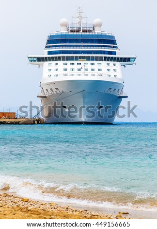cruise ship at the berth in the port of Rhodes Greece. Front view from the shore