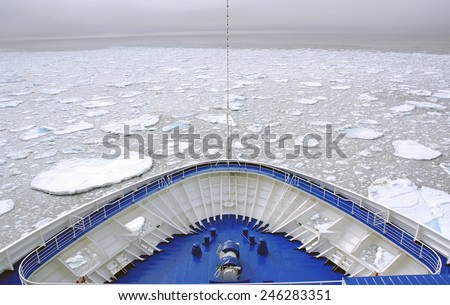 Cruise Ship bow passing icy snow arctic waters near Spitsbergen, Svalbard, Norway - stock photo