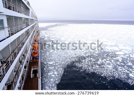 Cruise Ship bow passing icy snow arctic waters near Spitsbergen, Svalbard, Norway. - stock photo