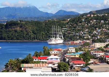Cruise ship coming into a caribbean city Roseau on the island of Dominica