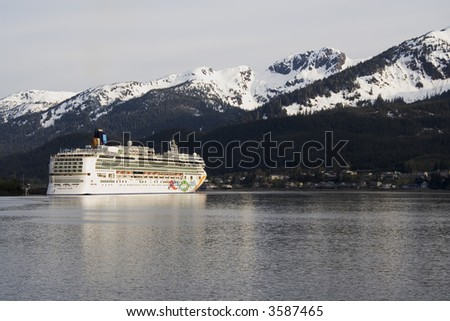 Cruise ship docked in Skagway Alaska with mountains in the background