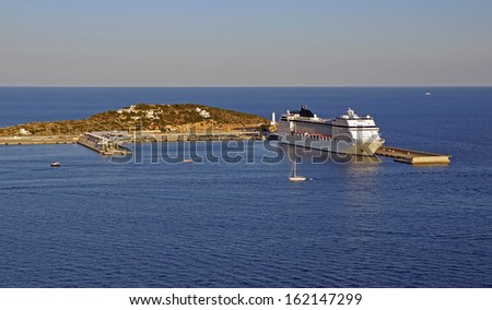 Cruise ship docks in the harbour in the port of Ibiza, Spain - stock photo