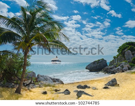 Cruise ship from the stern side sailing at the paradise beach with the palm tree over caribbean sand beach and lagoon. - stock photo