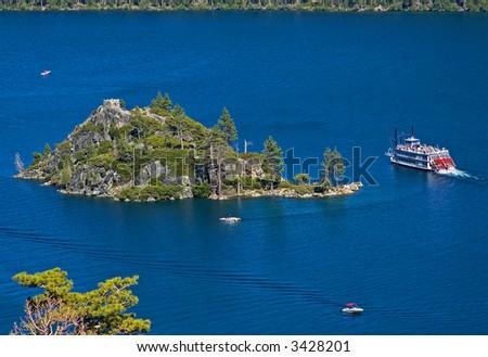 Cruise ship goes around Fanette Island in Lake Tahoe California - stock photo