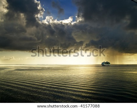 Cruise ship in a storm - stock photo