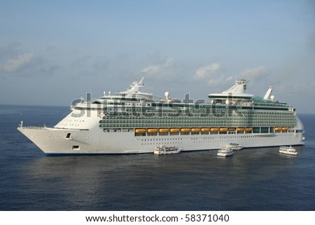 cruise ship in a tropical port - stock photo