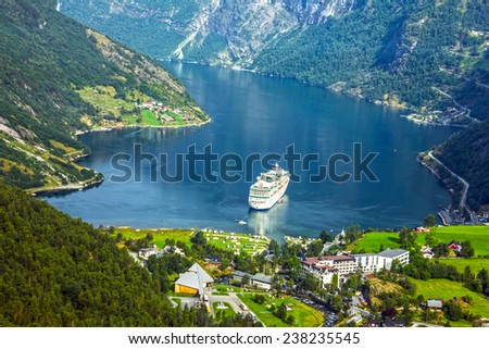 Cruise ship in Geiranger fjord, Norway - stock photo