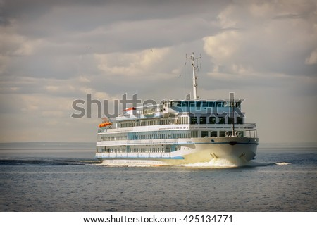 Cruise ship in open water, front view - stock photo