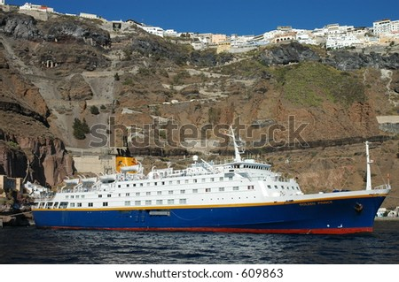 Cruise ship in Santorini, Greece - stock photo