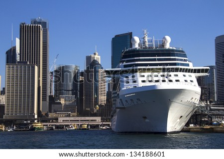 Cruise Ship in Sydney Harbour with Central Business District behind - stock photo