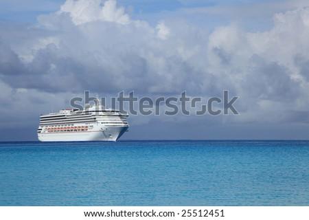 Cruise ship in tropical island ocean - stock photo