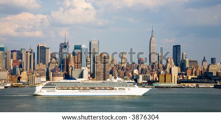 Cruise ship leaving Manhattan with NYC in background. - stock photo