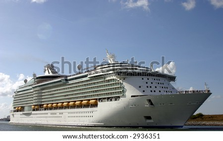 cruise ship leaving port for a dream vacation - stock photo