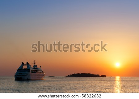 Cruise ship on sunset in Adriatic Sea - stock photo
