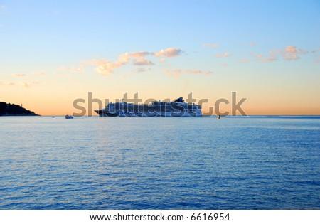 Cruise ship on the horizon - stock photo