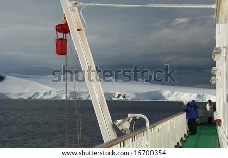 Cruise ship passenger photographing icebergs  and glacial mountains.Antarctica - stock photo
