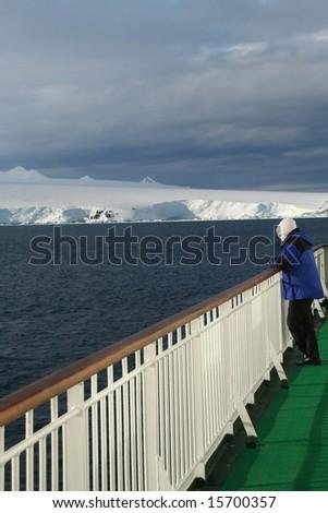 Cruise ship passenger viewing polar icebergs  and glacial mountains.Antarctica - stock photo