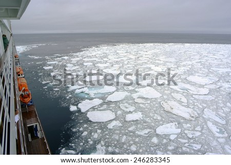 Cruise Ship passing icy snow waters near Spitsbergen, Svalbard, Norway - stock photo