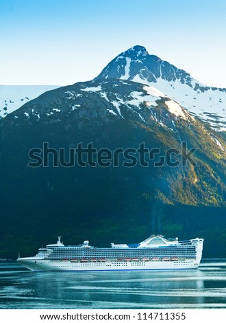 Cruise ship prepares to make it's way into the port of Skagway, Alaska - stock photo