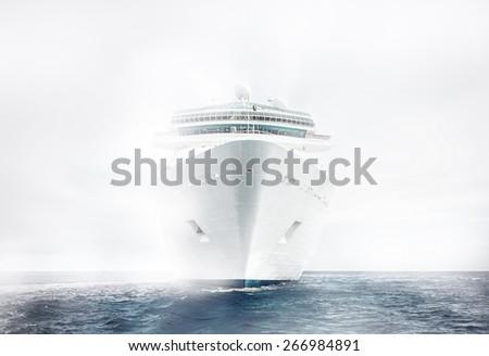 Cruise ship sailing in fog - stock photo