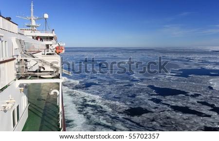 Cruise ship sailing the frozen blocks. - stock photo