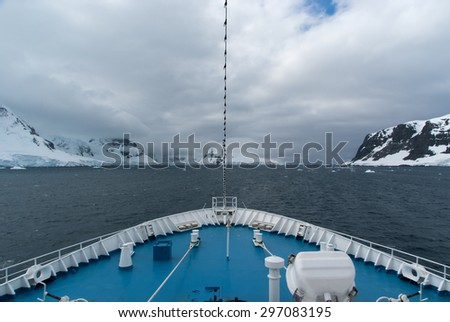 Cruise ship sailing through beautifull Lemaire Channel in Antarctica - stock photo