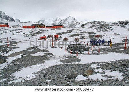 Cruise ship tourists visiting polar research station and colony,Argentine Base Esperanza,Antarctica - stock photo