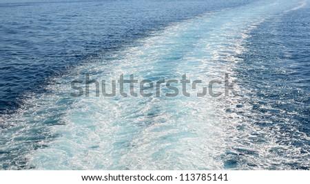 Cruise ship trails in open sea - stock photo