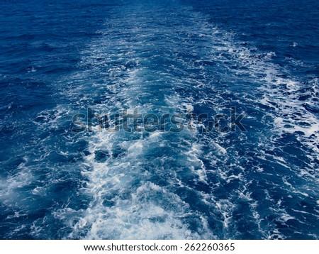 Cruise ship wake on the sea surface, ocean boat foam trail - stock photo