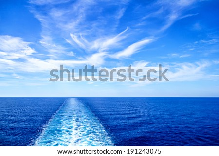 Cruise ship wake or trail on ocean surface - stock photo