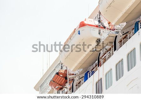 Cruise ship with lifeboats - stock photo