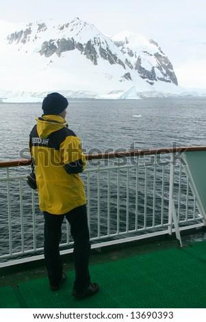 Cruise ship,   yellow parka, Erreras Channel, Antarctica - stock photo