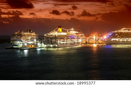 Cruise ships arriving in port at dawn - stock photo