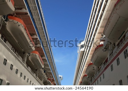 Cruise ships docked in tropical island port - stock photo