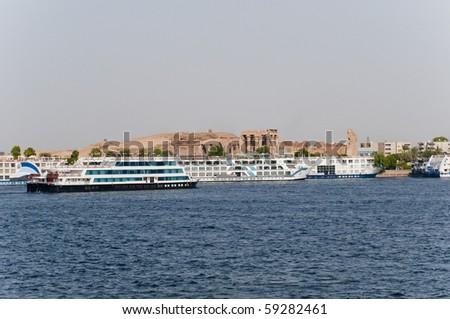 Cruise ships gather at Kom Ombo on the Nile, Egypt. - stock photo