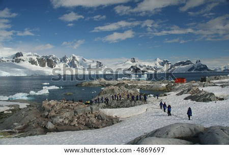 Cruise  tourists moving down to landing station, amid icebergs & glaciersPetermann Island,Antarctica - stock photo