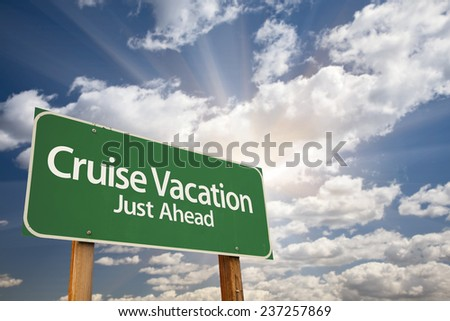 Cruise Vacation Just Ahead Green Road Sign with Dramatic Clouds and Sky.