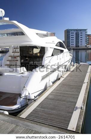 cruiser in marina - stock photo