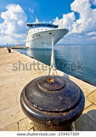 Cruiser ship tied on mooring bollard vertical view - stock photo