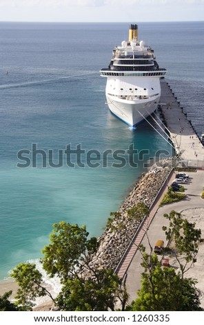 Cruiseship docking in a caribbean port - stock photo