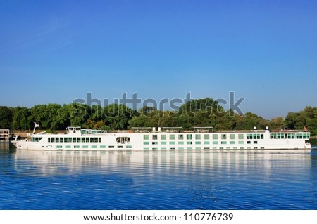 Cruising boat on the river - stock photo