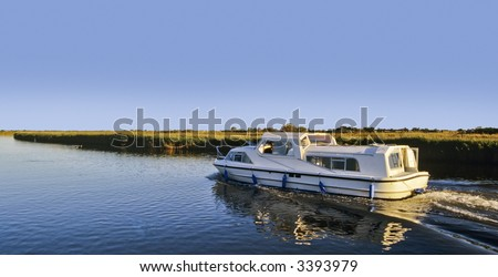 cruising on the norfolk broads river waveney berny arms  burgh castle norfolk broads national park east anglia england uk europe - stock photo