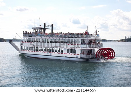 Cruising on the river on a steamer  - stock photo