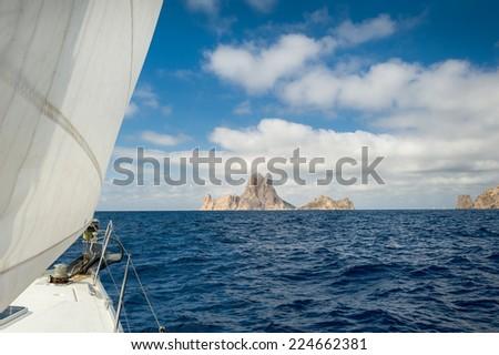 Cruising yacht sailing near Ibiza. Balearic islands, Eivissa, Spain - stock photo