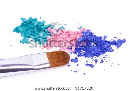 Crumbled eye shadows with professional make-up brush - stock photo